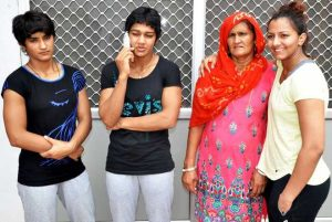 Mahavir Singh's wife and the wrestlers he coached to glory: Vinesh (niece, left ) and Babita and Geeta (daughters)